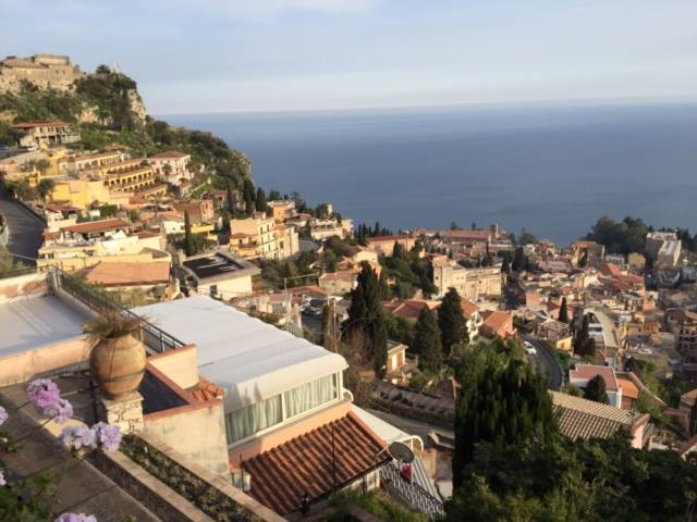 "A Curmudgeon travel gem on Sicily—Taormina Sicily – the bottom of Italy's west coast ""boot"" of in the distance."