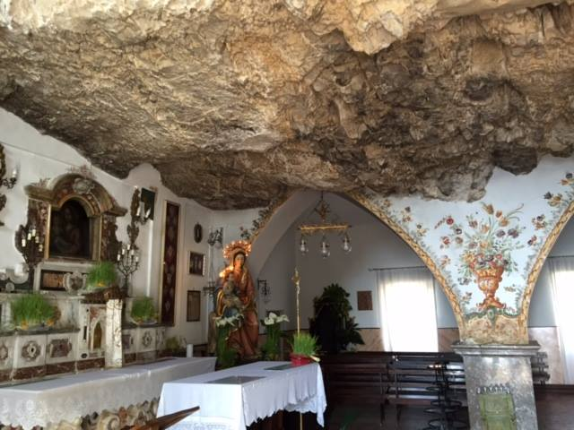 High a top a mountain overlooking Taormina – a small church carved out of a rock wall—note the rock interior ceiling.